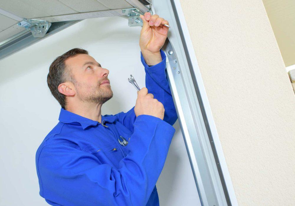 Repairing a garage door hinge